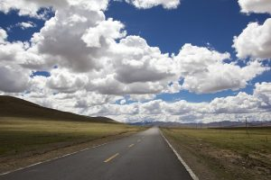 panoramic view - clouds and the road