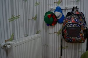 Backpack and hats on the wall