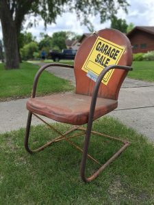 Chair with a garage sale sign on it