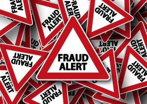 Signs saying fraud alert