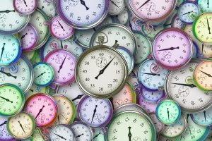 A bunch of colored clocks