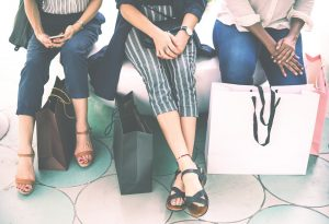 Girls sitting with shopping bags