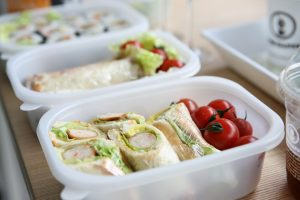 lunch boxes with food in them