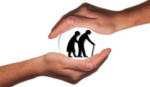 Hands showing care towards the elderly