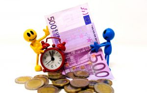 figurines holding clock and euro bill