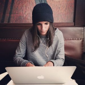 A girls searching on her laptop top priorities when moving