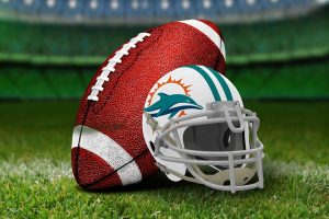 A Miami dolphins helmet and a ball