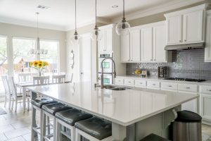 White kitchen with a white kitchen island.