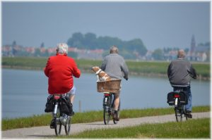 Old people on bicycles.