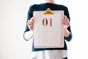 Person holding a calendar.