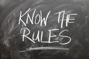"""Words written on chalk board saying """"know the rules'"""