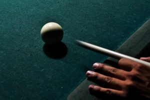 Person playing pool.