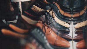Dress shoes on a shelf.