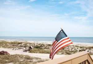 American flag on a beach.