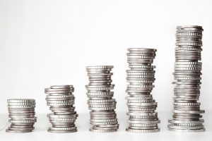 Stacked coins saved from using eco-friendly storage units