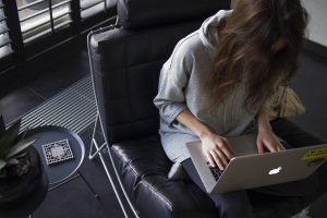 woman writing on laptop - reward movers for a job well done