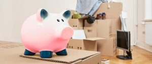piggy bank and moving boxes