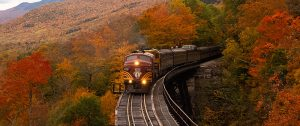 a train on rails in the fall