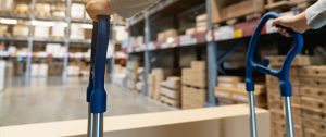 storage Florida - man strolling a box in a storage facility