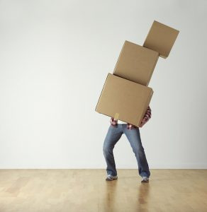 Man carrying boxes.