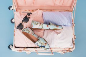 Suitcase with clothes.