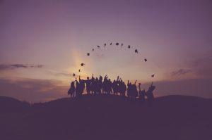 A group of graduates at dawn.