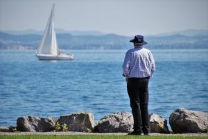 A man looking at a lake after moving to Pompano Beach FL.
