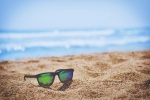 living in lake worth FL- sunglasses in the sand