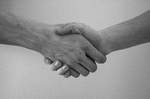 Shaking hands to handle to disputes with movers