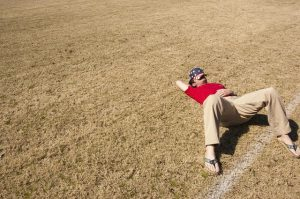 A man resting on the grass