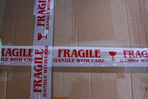 A box taped with labeled tape