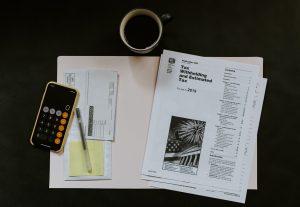 A calculator and paperwork