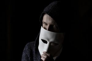 Scammer with a mask