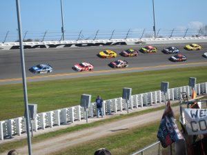 A race track full of brightly colored race cars