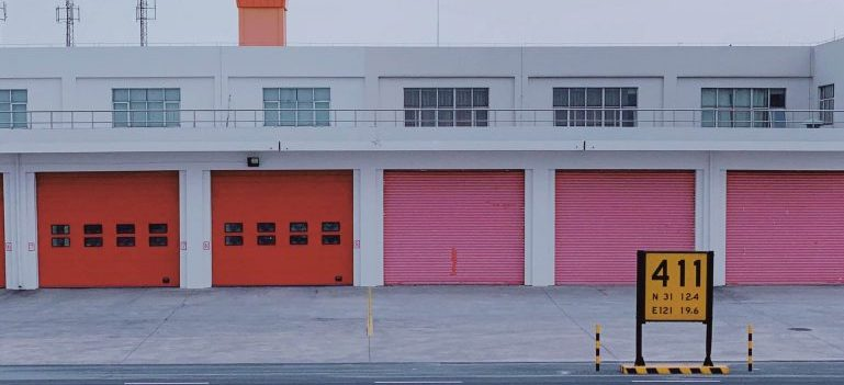 Red and pink storage unit doors - let us find the best local movers Deerfield Beach who offer storage services