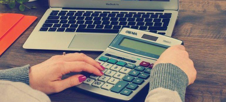 a female person using calculator