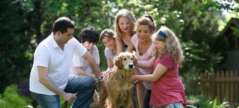 a family surrounding their dog