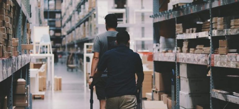 two people in a warehouse
