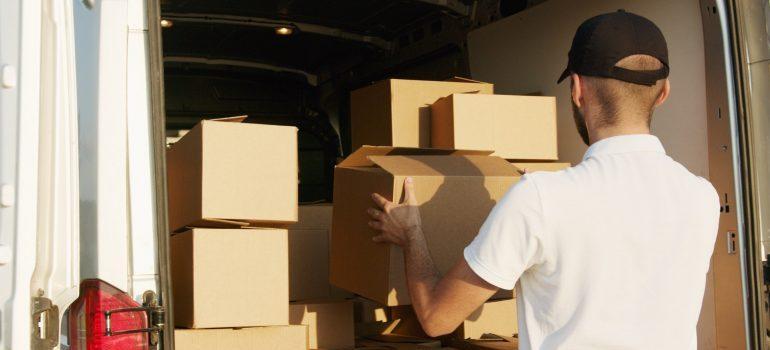 a man lifting the box