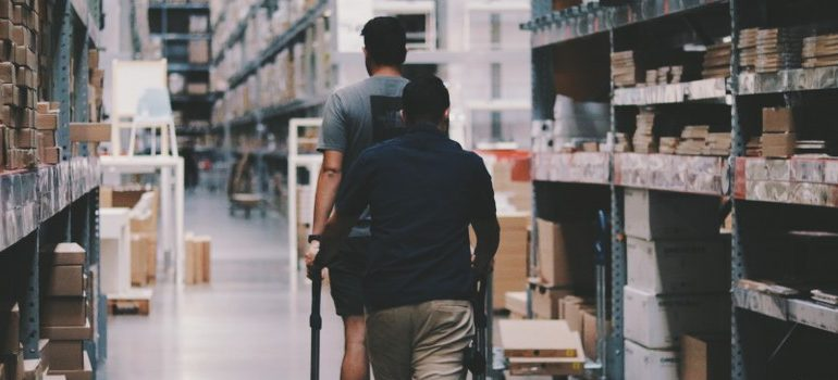 two people at the storage, warehouse