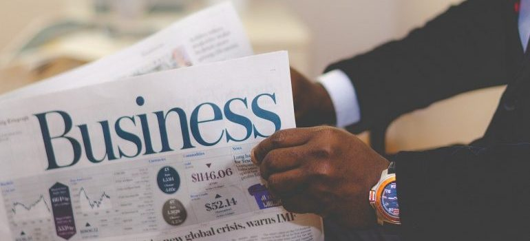 A person holding business papers.