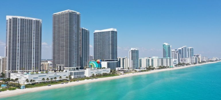 the image of the beach and buildings in Hallandale Beach