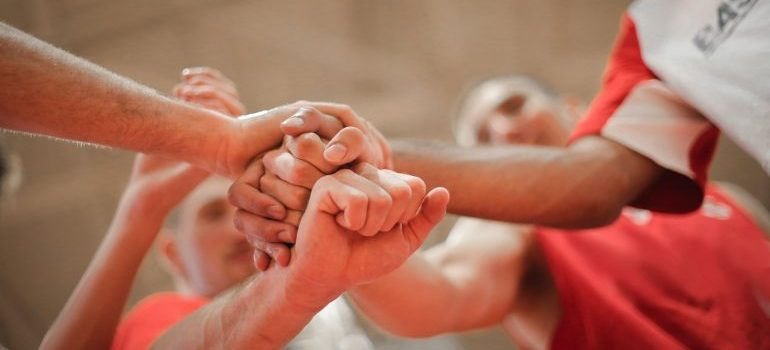 A team stacking hands.