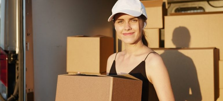 a smiling female employee of best movers Hallandale Beach