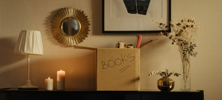 a box labeled books on a shelf