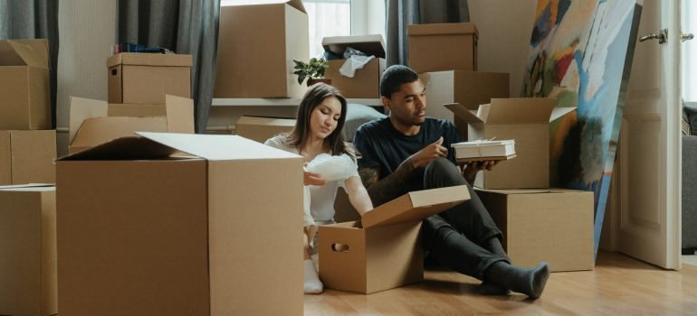 couple packing for the move, waiting for local movers cape coral fl