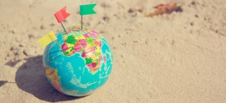 A globe on the sand.