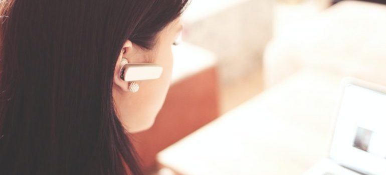 woman working in customer service with earphones