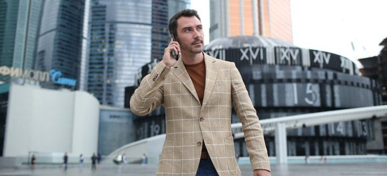 A man on the street making a phone call.