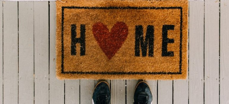 residential movers Jupiter FL - a welcome mat leading to your new home